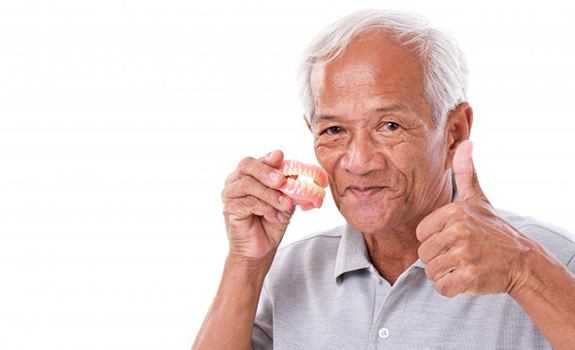 Man with dentures in Rockwall gives thumbs up
